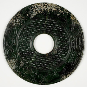 Large Disk with Bands of Small Protuberances and Incised Bovine Masks