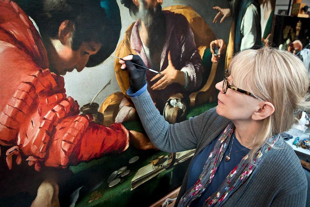 George F. and Sybil H. Fuller Term Chair in Conservation and Chief Conservator Rita Albertson treating a 17th c. painting