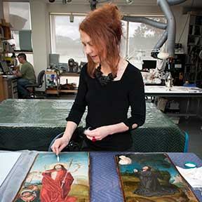 Paintings Conservator Birgit Straehle carrying out surface cleaning tests on 16th c. panel paintings