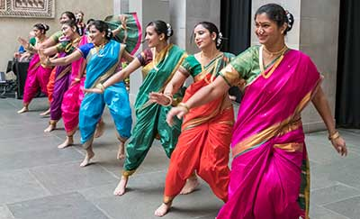A colorful Diwali dance performance by women in traditional Indian dress