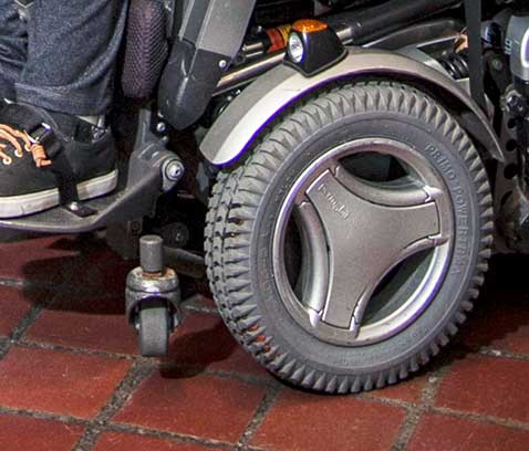 Close up of a wheel on a motorized wheelchair