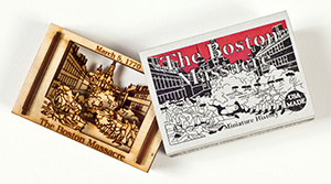 A miniature carving of the Boston Massacre in a matchbox